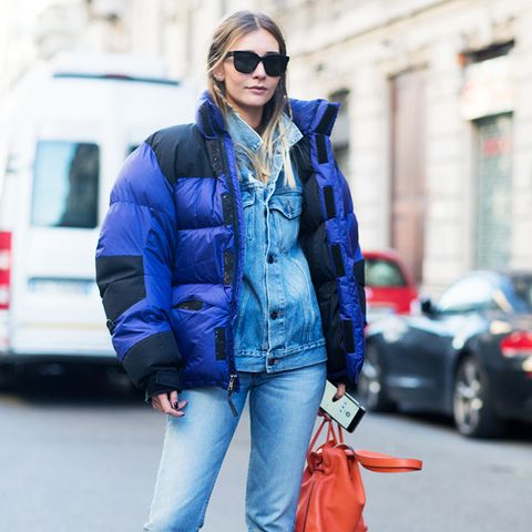 double denim: with a puffa jacket and a bold pair of shoes and a bright bag