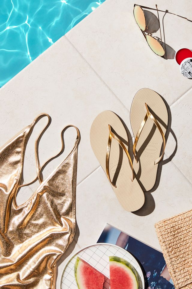 As the color most closely representing sunshine, gold will forever be our go-to metallic hue for summer. And while in other seasons, a gold lamé swimsuit might be considered a little extra,...