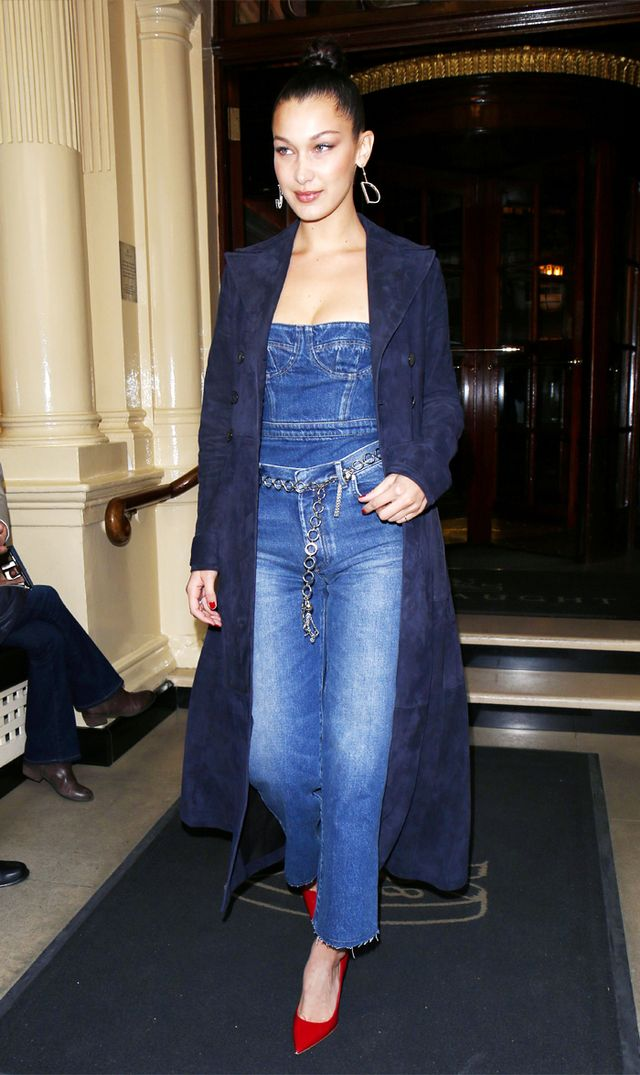 On Bella Hadid: Dior coat, top, jeans, earrings and shoes.