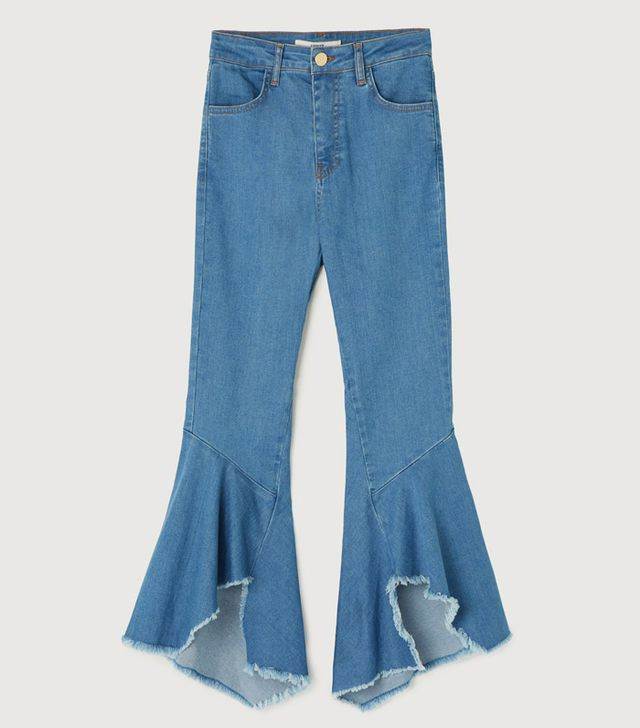 Uterque Frayed bell bottom jeans