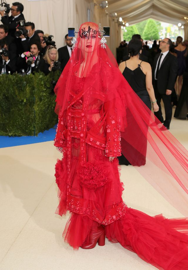 "WHO: Katy Perry WEAR: Maison Margiela ""artisanal"" designed by John Galliano, red décortiqué embroidered wool coat layered over a red tulle and silk chiffon dress..."