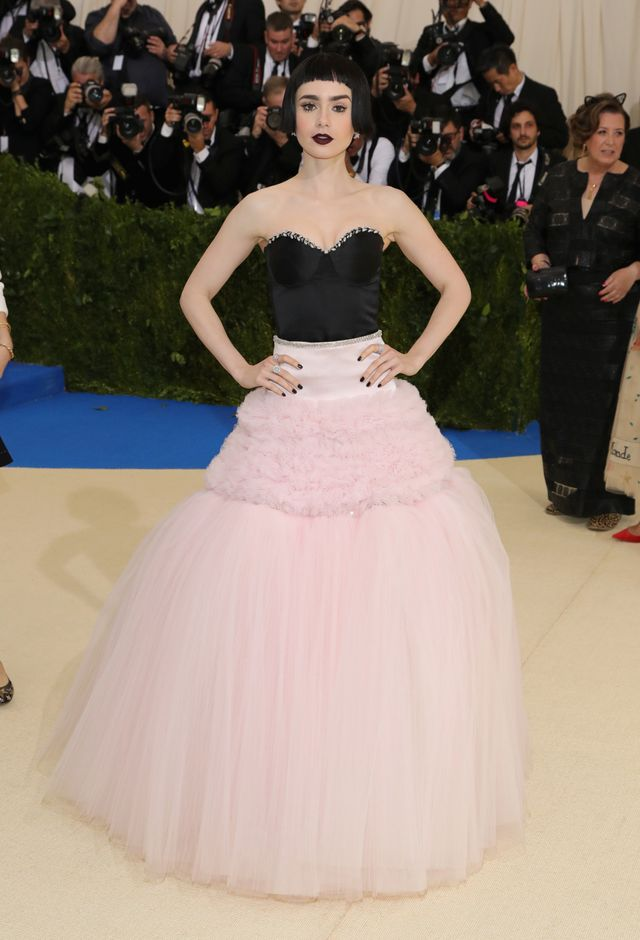 WHO: Lily Collins WEAR: Giambattista Valli dress; Tiffany diamond cluster earrings and an assortment of diamond rings.