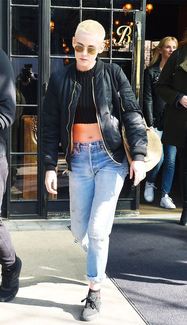 Kristen Stewart style: boyfriend jeans, black crop top and bomber jacket