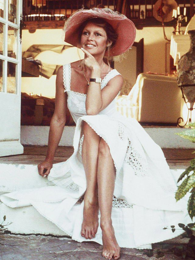 Style Notes: A floppy hat and a white broderie anglaise dress make for a timeless summer fallback, not to mention a grown-up way to do boho.