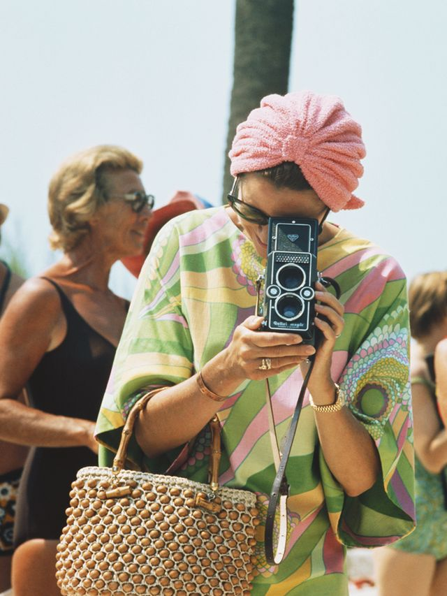 Style Notes: So good we had to include her twice, Grace continued her beach vibes well into the '70s. This Pucci dress reflects this summer's bold colours while the towel turban and beaded...
