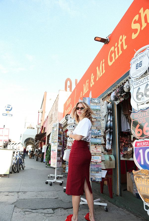 A pencil skirt usually screams business, but when you pair it with a graphic tee and some fun slides, you've suddenly got the most elegantly casual look out there. On Courtney Trop: Copson...