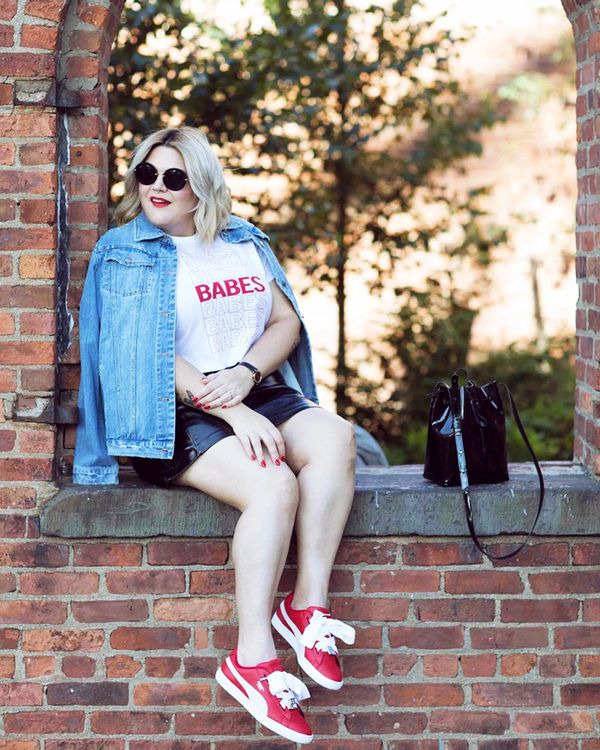 You can never go wrong with a denim jacket and sneakers combo. Try a bold red pair to match a fun graphic tee. On Nicolette Mason: Premme Feminist AF Jacket ($89) and Babes Crop Tee ($35); Puma...