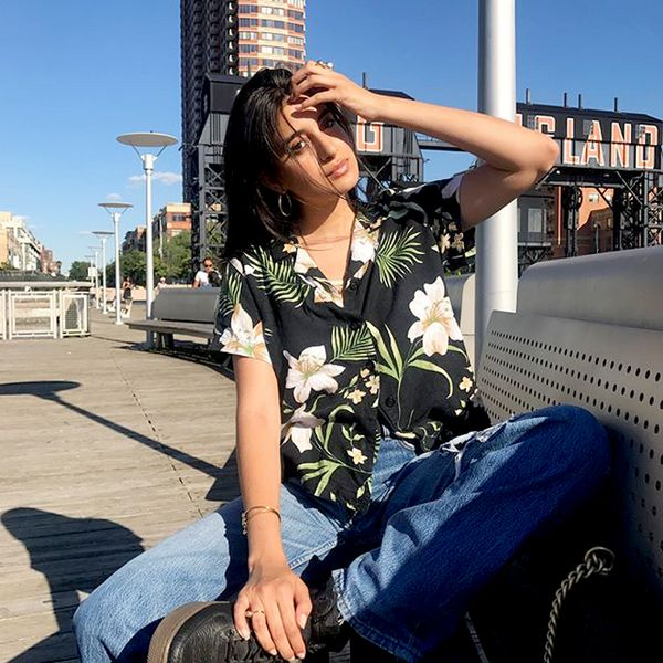 Embrace tropical vibes in a laid-back Hawaiian shirt—add denim, cool sneakers, and a pile of jewelry for an instantly cute-casual look. On Anaa Saber: Nike SF Air Force 1 Mid ($160)