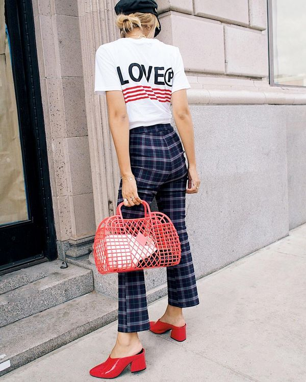 Plaid pants are a fall favorite right now, and with a few red accents, they make an outfit pop. On Stephanie Arant: Urban Outfitters Lover Striped Tee ($29) and Lola Plaid Kick Flare Pants ($49);...