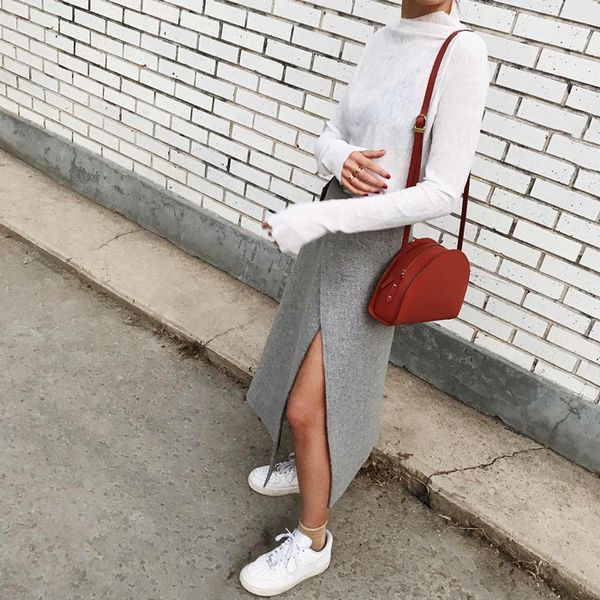 Pair neutral tones like a pro by playing with texture and shape. Classic white kicks like these Nike's keep is casual. On Elif Filyos: COS skirt; The Stowe Margo Half Moon...