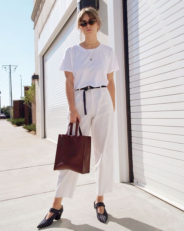 Try a pared-back, minimalistic combo of white and off-white. With a few dark accessories to punctuate it, your monochrome outfit will look fresh and clean. On Courtnee Ruthie: Organic Basics...