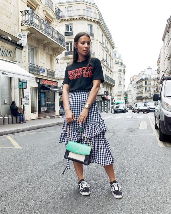 Give a flirty piece like a ruffled skirt the tomboy treatment by wearing it with a graphic tee and classic sneakers (the more worn-in-looking, the better). On Alice Barbier: ASOS skirt; Urban...