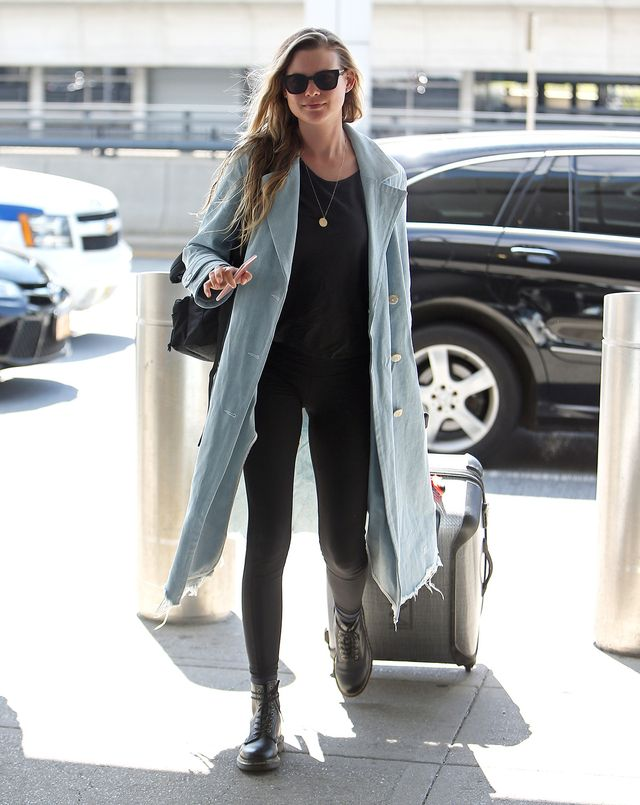 On Behati Prinsloo: Alexander Wang Oversized Denim Trench Coat ($950); Erth Large Plate Necklace ($810); Vetements x Eastpak Mini Backpack ($620); Dr. Martens 1460 Boots ($135). Similar Style: Old...