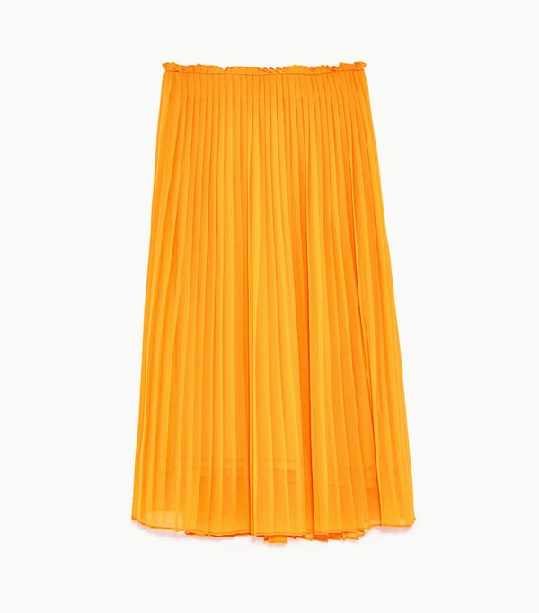 What to wear with a pleated skirt: Orange skirt