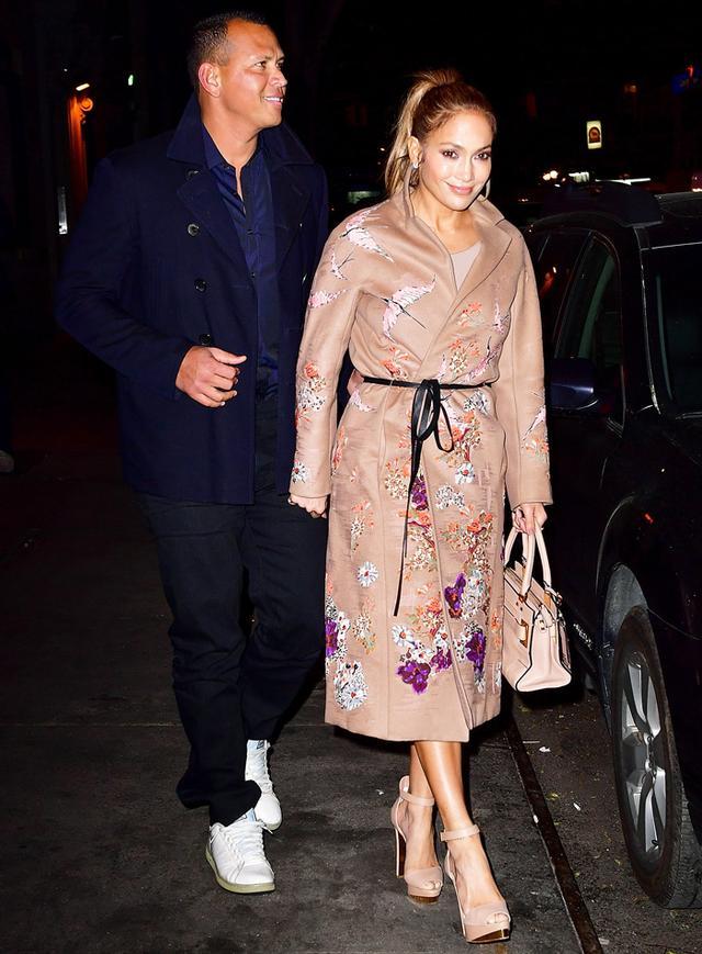 On Lopez: Valentino coat.
