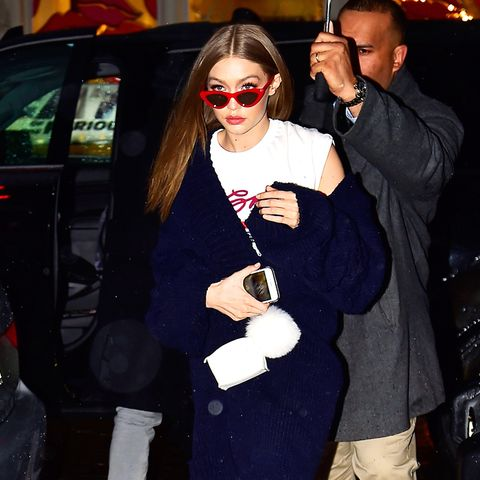 Celebrities wearing trainers: Gigi Hadid red trainers