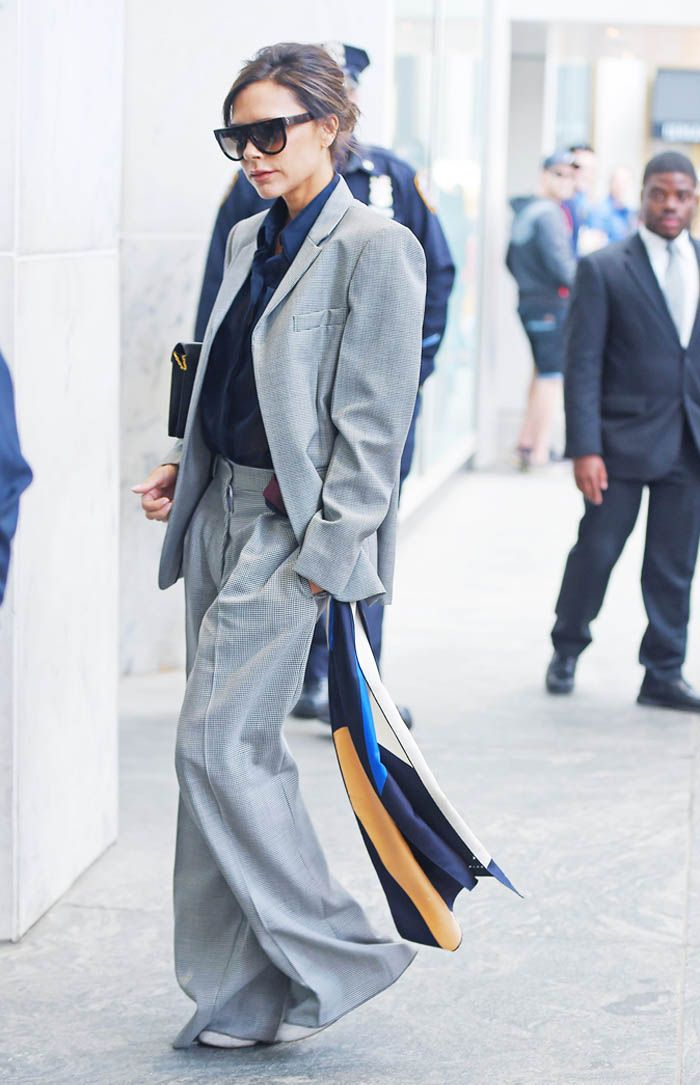 Victoria Beckham wearing grey trouser suit