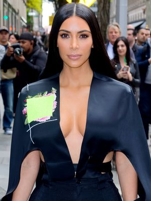Kim Kardashian West Wore Leggings, Boots, and a Cape in NYC