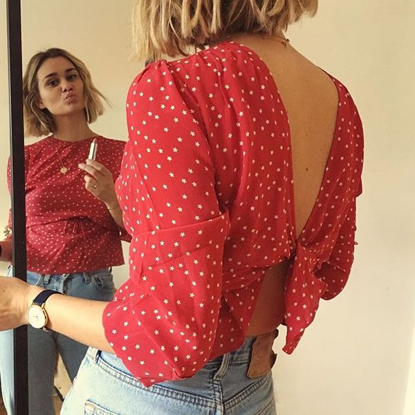 Here she styles it on top of a quintessentially French-looking red-and-white polka-dot silk blouse.