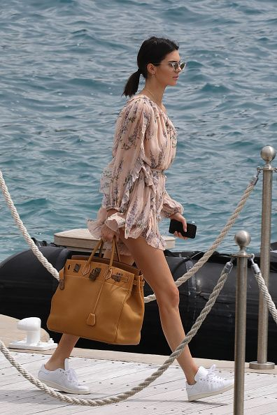 On Jenner: Le Specs x Adam Selman The Last Lolita Sunglasses ($75); Zimmermann Romper; Hermès Bag; Adidas by Raf Simons Stan Smith Sneakers ($400). Jenner showed us how to wear sneakers on...