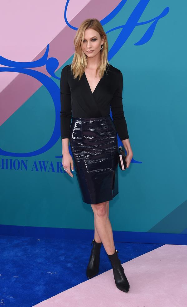 WHO: Karlie Kloss WEAR:Diane von Furstenberg bodysuit, skirt and boots.
