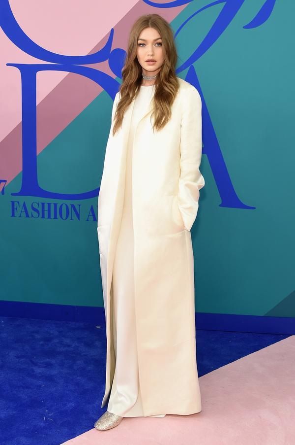 WHO: Gigi Hadid WEAR: The Row dress and jacket; Stuart Weitzman shoes.