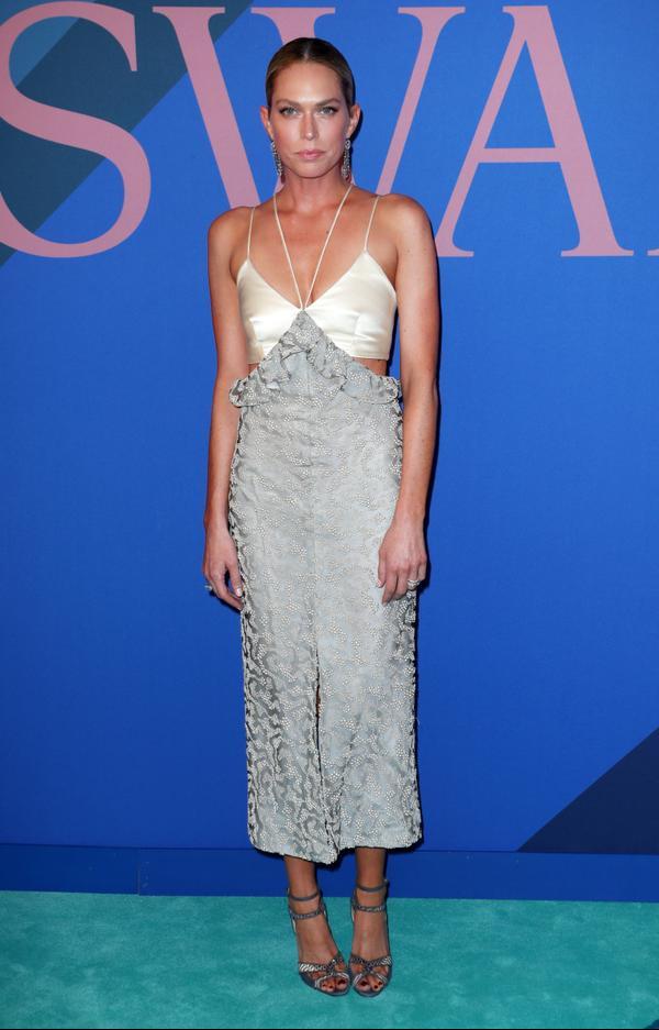 WHO: Erin Foster WEAR:Markarian dress;Sarah Flint shoes.