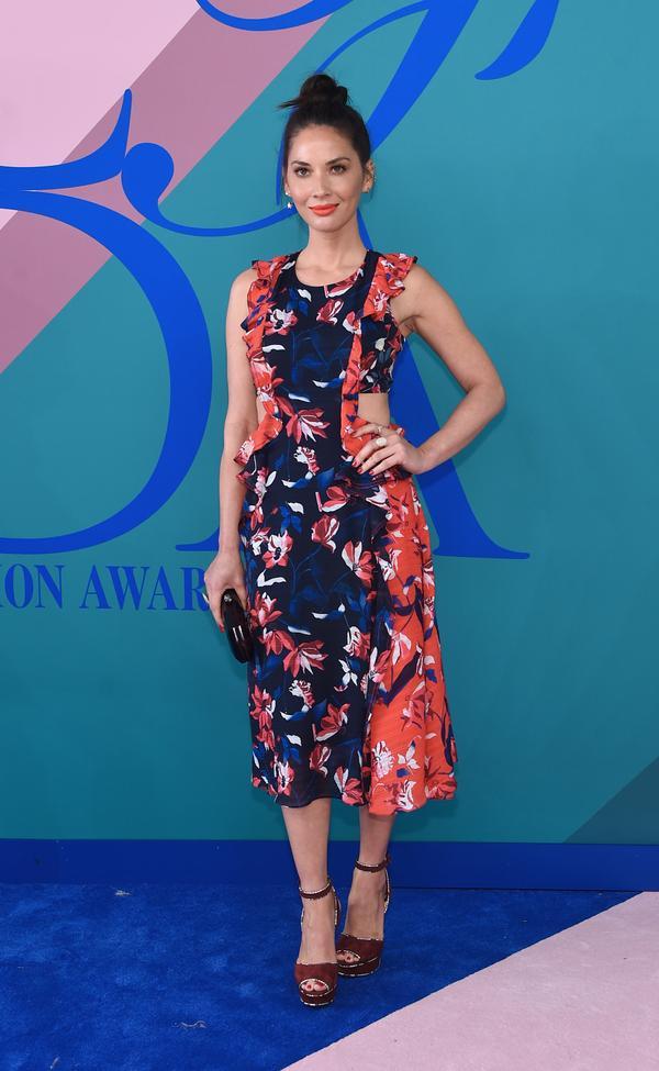 WHO: Olivia Munn WEAR: Tanya Taylor dress;Tyler Ellis clutch;Delfina Delettrez earrings.