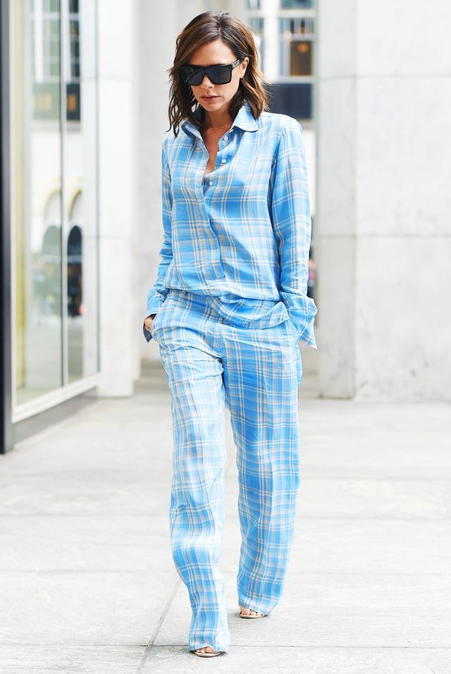 On Victoria Beckham: Victoria Beckham Resort 18 shirt and trousers.