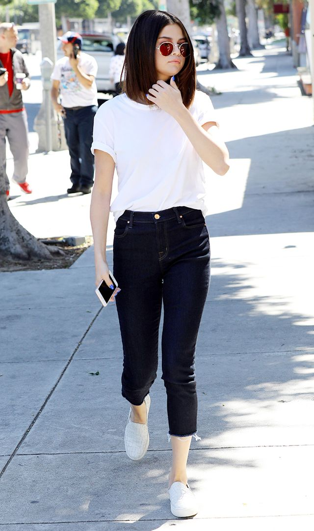 Selena Gomez in white shirt and jeans