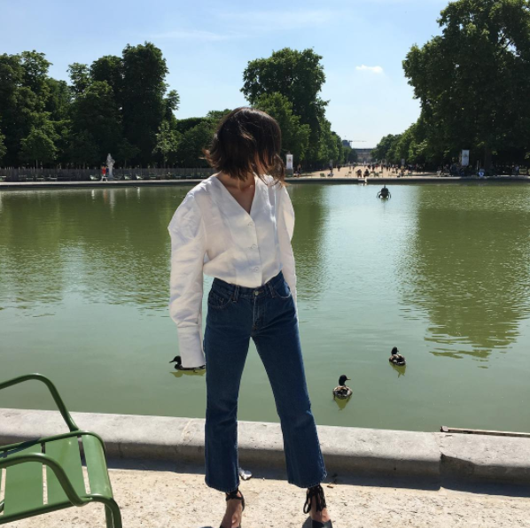 Gabriela Pelletier in white blouse and jeans in Paris