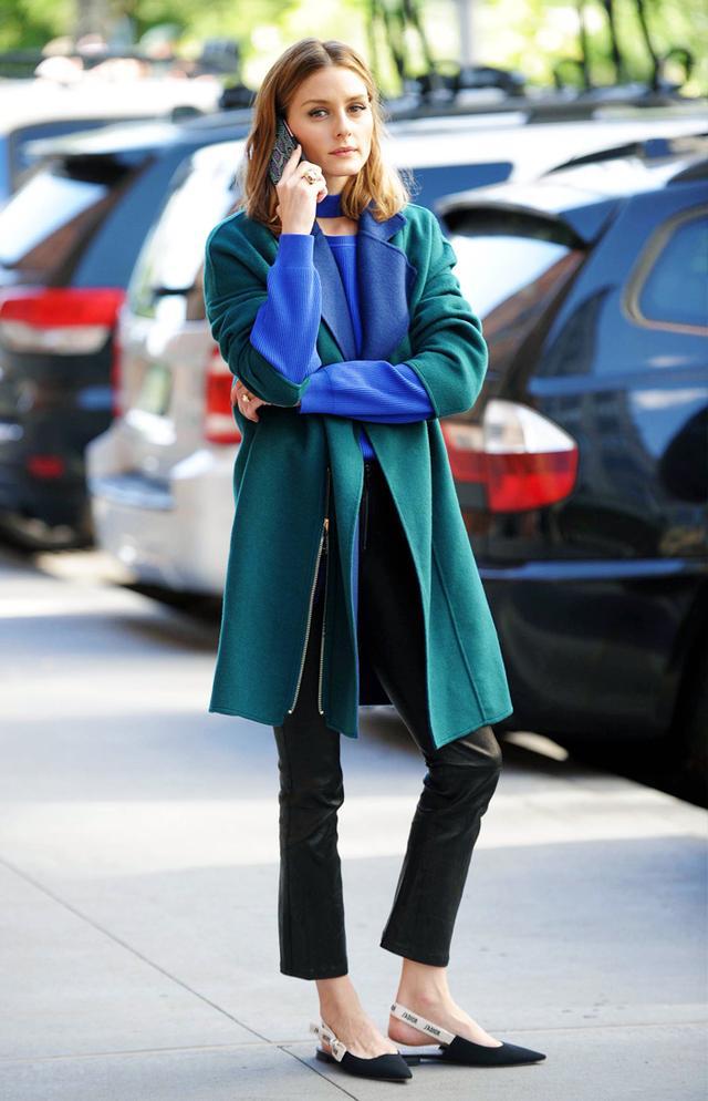 On Olivia Palermo: Topshop Choker Crew Knit Jumper (£45); Paige Carine Pant (£895); Max & Co Reversible Two-Tone Coat(£475) Dior Slingbacks (£580).