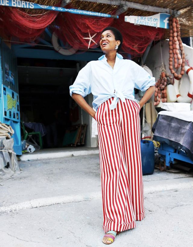 Style Notes: Tamu McPherson's red-and-white striped trousers look effortless with her oversize blue shirt with rolled-up sleeves and tied at the waist.