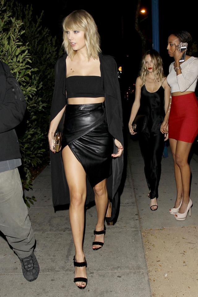 On Taylor Swift: Meshki trench coat.