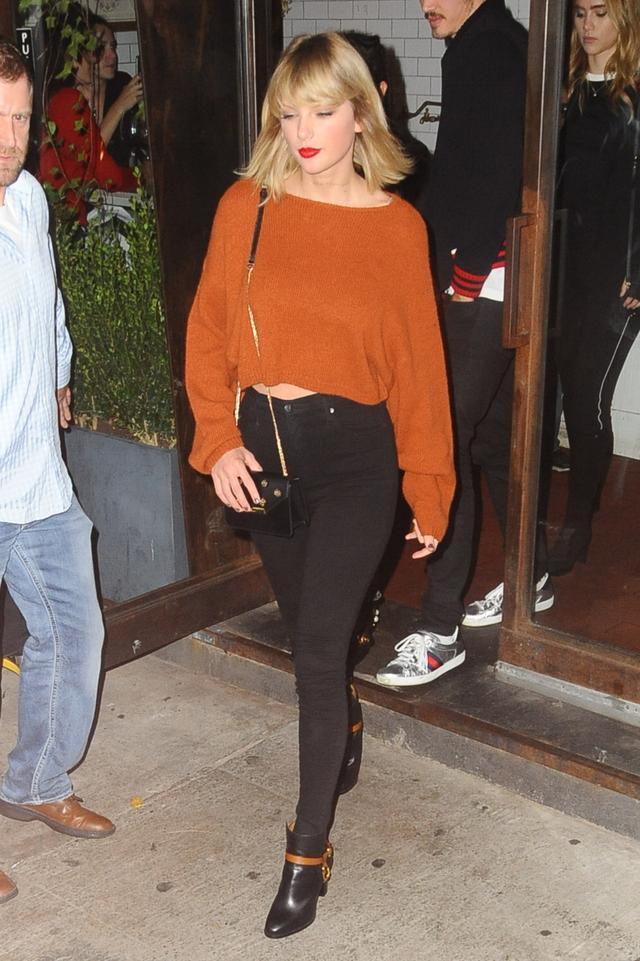 On Taylor Swift: Elizabeth and James sweater; Frame Le Skinny de Jeanne Jeans($180); Ralph Lauren boots, L.K.Bennett bag.