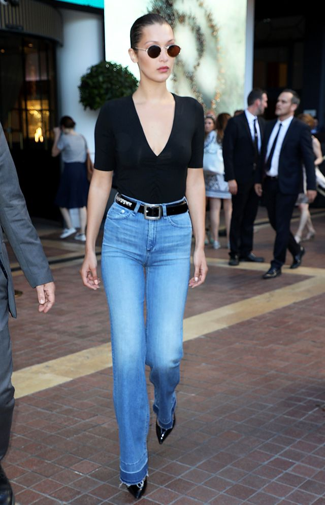 bella hadid in v-neck t-shirt jeans outfit
