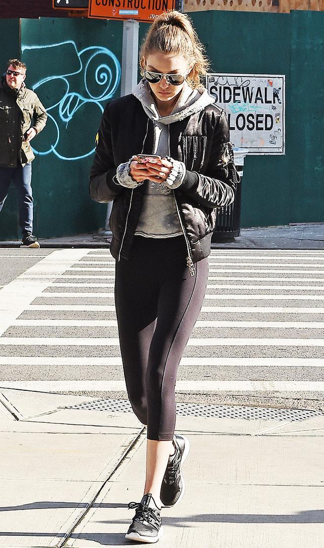 gigi hadid wearing leggings and black sneakers