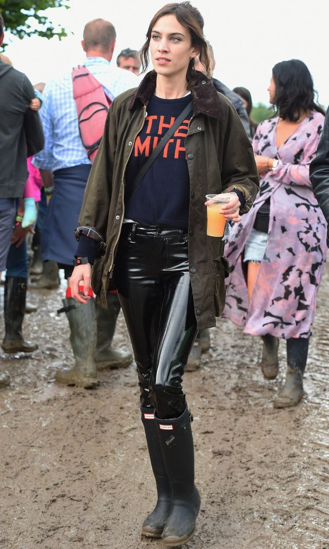 Chungditches the leather pants this year andteams a vinyl pair with a slogan tee and brown coat—all while keeping things casual and mud-friendly withHunter gumboots.