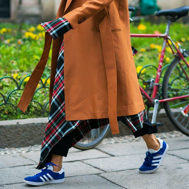 Suede trainers trend: woman wearing Adidas Gazelles