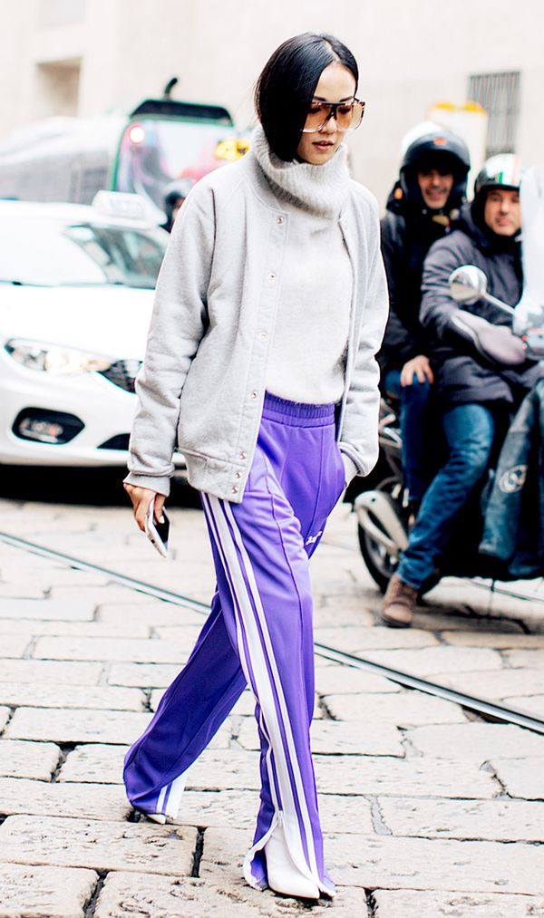 Unzip the bottom of your track pants to expose a pair of statement shoes. To really nail the athleisure trend, wear a bomber jacket too.