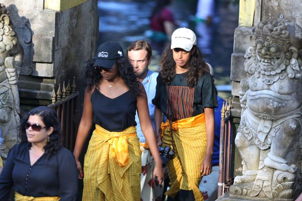 On June 27, the family visited the Tirta Empul Templeat Tampaksiring Village in Gianyar, which is famous for its holy water. Sasha, Malia, and Michelle (not pictured) all donned matching...