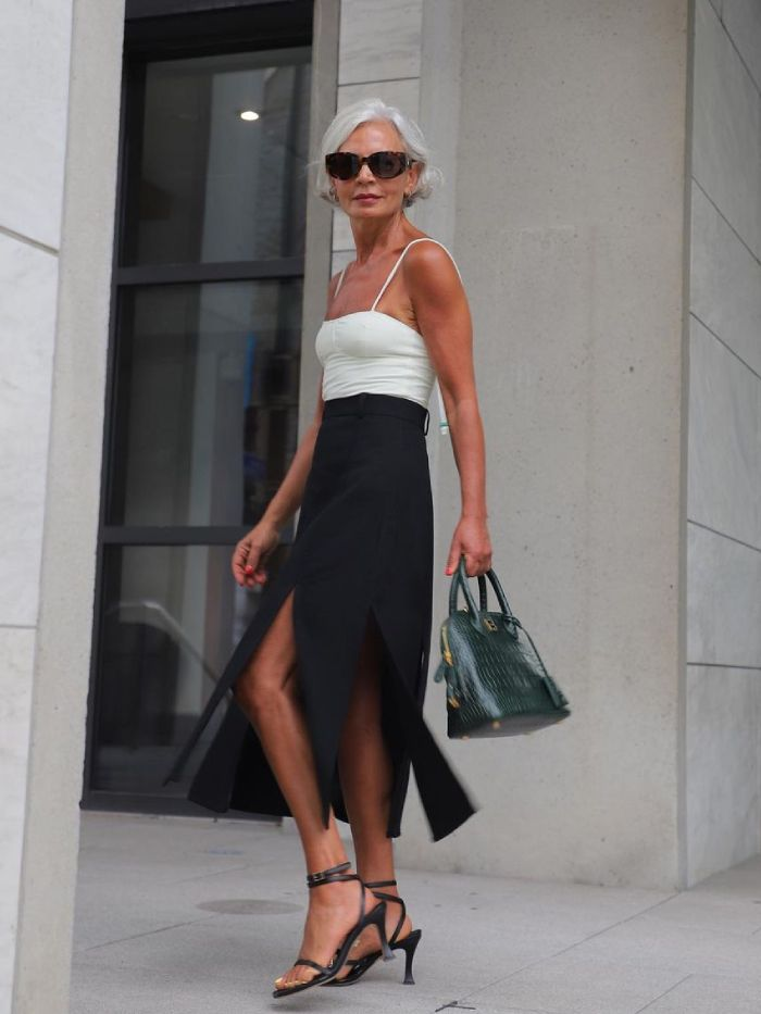 what to wear to an autumn wedding: grece ghanem in a white top and black skirt