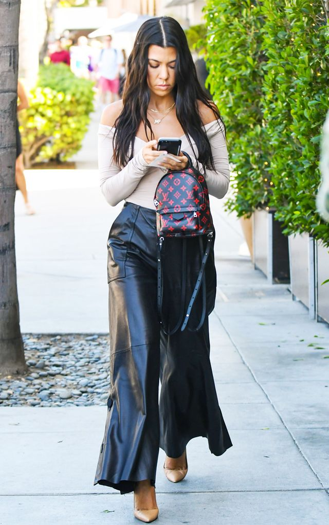Kourtney Kardashian style: black leather trousers