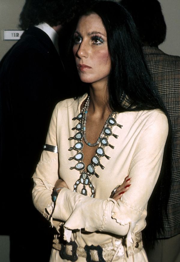 Style Notes: It's 1974, it's Los Angeles and Cher's style riffs on her Cherokee heritage. Her jewellery collection is one we'd like to explore.