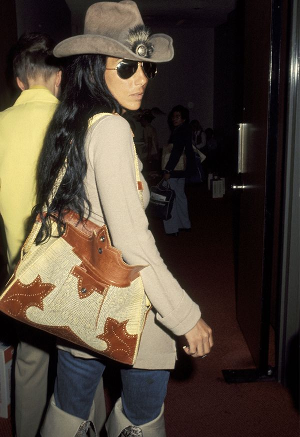 Style Notes: This is an LAX airport look waiting to happen this year—Cher nailed the cowgirl thing back in '77.