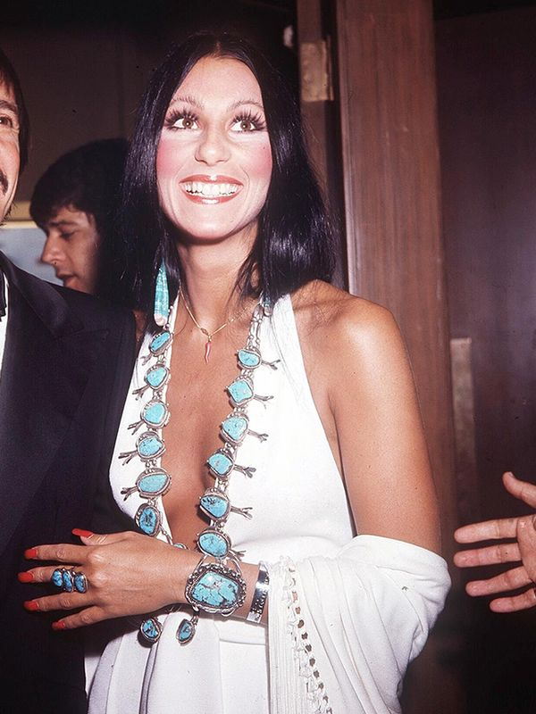 Style Notes: Making us want to restock on turquoise jewellery once more, Cher styled up a simple white dress with her stones in 1976.