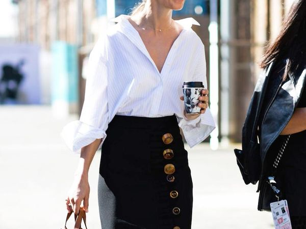 Nothing beats a classic button-down, especially when paired with a high-waisted skirt and delicate jewelry.