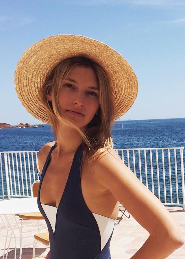 Lucillia Chenel in a straw hat