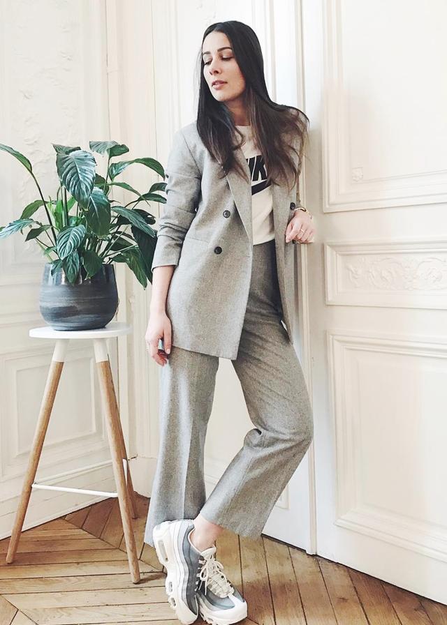 Alice Barbier in grey suit