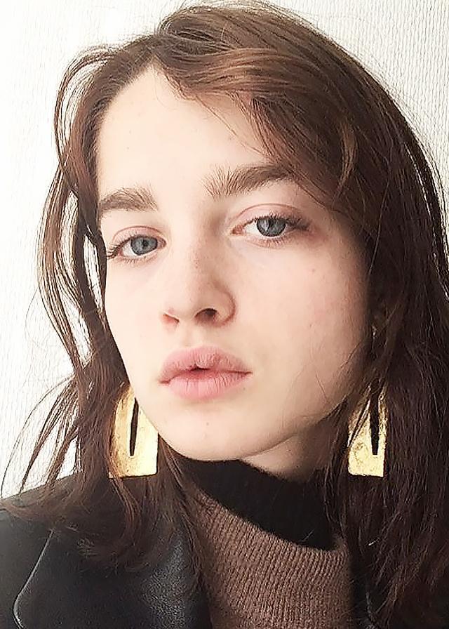 Adèle Farine in oversized earrings